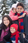 East Indian family playing in the snow — Stock Photo