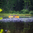 Stock Photo: Canoe on lake with family