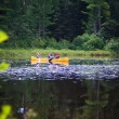 Canoe on the lake with the family — Stock Photo