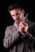 Gangster or private detective with a pistol — Stock Photo