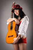 Woman holding classic guitar — Stock Photo