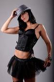 Beautiful brunette wearing a black tutu — Stock Photo