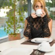 Woman having coffee in the morning - Photo