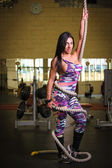 Beautiful woman on the gym — Stok fotoğraf