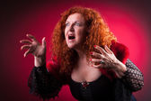 Woman playing bad witch — Stock Photo