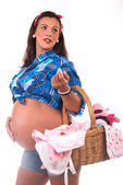 Pregnanto woman carring a wicker basket — Stock Photo