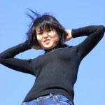 Girl on background sky — Stock Photo