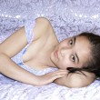 Beautiful making look younger girl in bed — Stock Photo