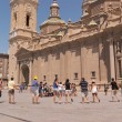 Pilgrims dancing and singing in Plazdel Pilar, Zaragoza — Stock Photo #13659818