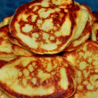 Ruddy pancakes on a plate — Foto de Stock