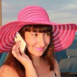 Girl in a hat talking on the phone — Stock Photo