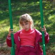 Stock Photo: Girl in sports suit on swing
