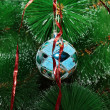 Blue Christmas ball on the tree — Stock Photo
