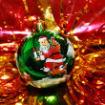 Green Christmas ball in a golden tinsel — Stock Photo #17473003