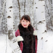 Beautiful girl about two birches — Stock Photo