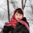 Pretty woman in pink scarf in the winter woods — Stock Photo