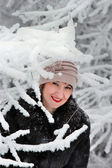 Girl in winter coat and hat in winter forest — Stock Photo