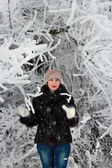 Girl in a snowy tree — Stock Photo