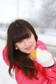 Beautiful girl with mandarin in hand — Stock Photo