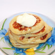 Royalty-Free Stock Photo: Small pancakes with sour cream on the plate
