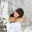 A smiling girl in a white jacket in winter — Stock Photo