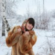 Girl in fox fur coat and beautiful shawl in winter forest — Stock Photo #21582111