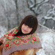 Beautiful girl in a fur coat and a scarf in the winter woods — Stock Photo