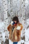 Girl near birch trees in the woods drinking tea — Stock Photo