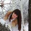 Cheerful girl in winter forest — Stock Photo
