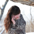 Stock Photo: Girl in leopard dress talking on the phone