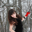 Beautiful girl in red gloves — Stock Photo #22819594
