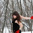 Girl in winter forest in a black dress — Stock Photo #22819618