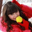 Young brunette in a winter forest, eating apple — Stock Photo #22819882