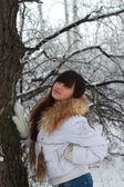 Thoughtful girl near the tree — Stock Photo
