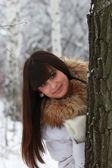 Girl in winter forest near Oak — Stock Photo