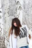 Thoughtful girl near birches — Stock Photo