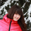 Beautiful girl in winter near the fir — Foto Stock
