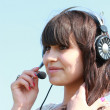 Young brunette in headphones with mikrafon — Stock Photo