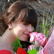 Stockfoto: Brunette enjoys scent of roses
