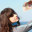 A young girl with a five-thousand dollar bills in her hand — Stock Photo