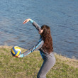 A girl playing volleyball - Stock Photo