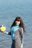 Beautiful young girl with a volleyball ball — Foto de Stock