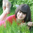 Happy brunette woman relaxing on nature - Stockfoto