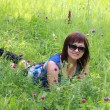 Stock Photo: Attractive womlying on grass