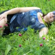 Stock Photo: Girl lying on grass