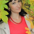 Stock Photo: Portrait of pretty womamong autumn leaves