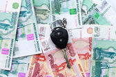 Car key and Russian money. — Stock Photo