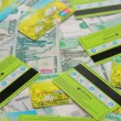 Stock Photo: Plastic bank cards and Russimoney thousandths