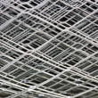Fragment of a grid metal — Stock Photo