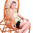 Portrait of beautiful young blonde in chair — Stock Photo #39851589